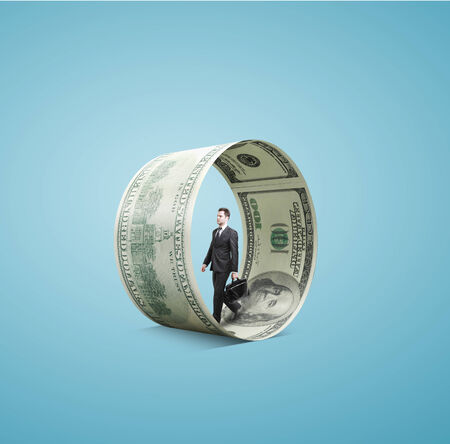 businessman walking in money wheel  on blue background photo