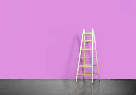 realistic concrete floor and pink wall with ladder photo