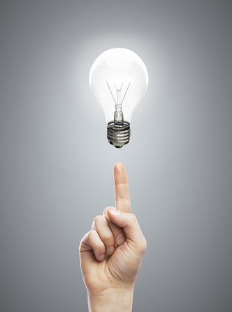 hands pointing at bulb, idea concept Stock Photo - 24125529