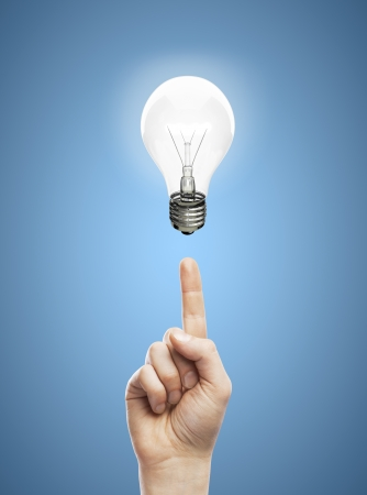 hands pointing at lamp,  idea concept Stock Photo - 24125677