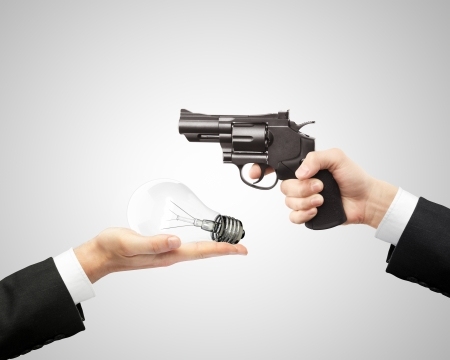 hands holding gun and bulb Stock Photo - 24125685
