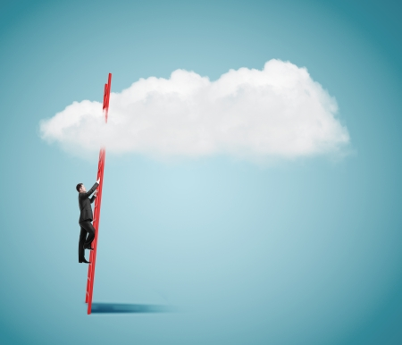 man standing on ladder and looking to cloud photo