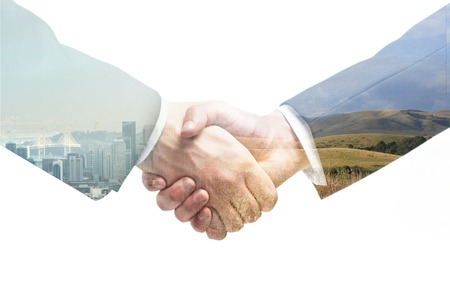 business handshake on a city and field background Stock Photo