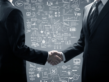 business decisions: business handshake on a business concept background Stock Photo