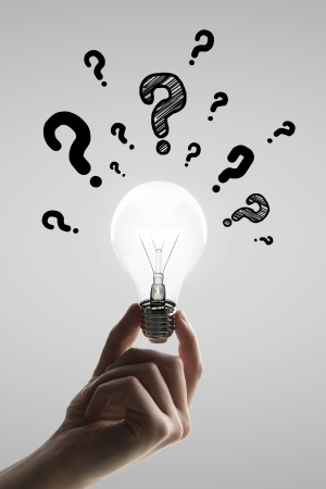 hand holding bulb with question mark Stock Photo - 24288037