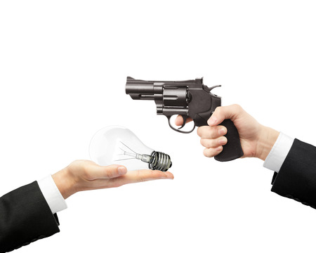 hands holding gun and bulb photo