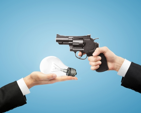 hands holding gun and lamp Stock Photo - 24288087