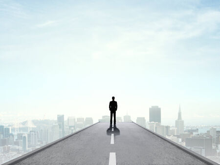 businessman standing and looking on city photo