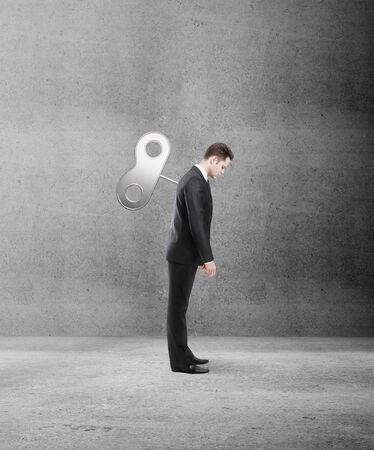 winder: businessman standing  with winder back in room