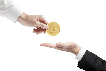 hand giving bitcoin on a white background Standard-Bild