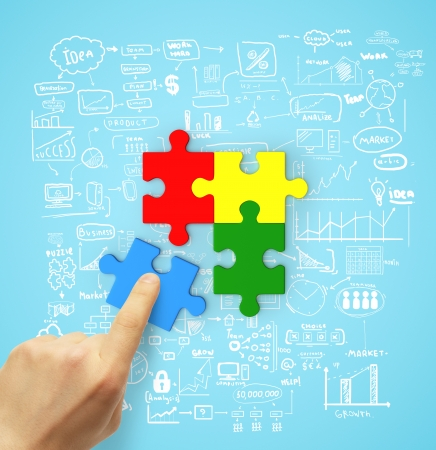 hand holding color puzzle, business concept