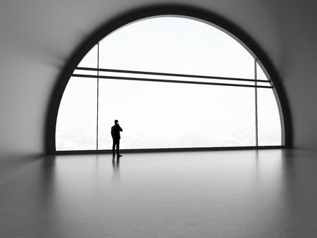 businessman standing in futuristic office photo