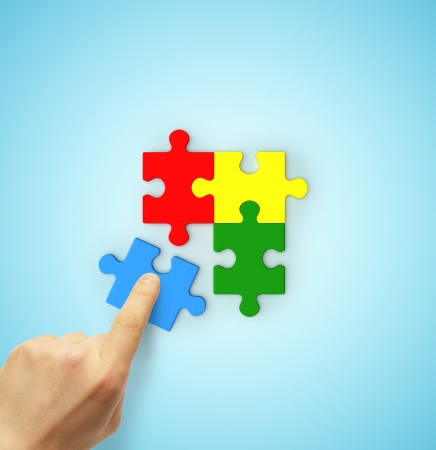 hand holding color puzzle isolated on white