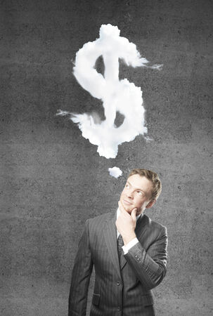 young businessman thinking on money Stock Photo - 24419045