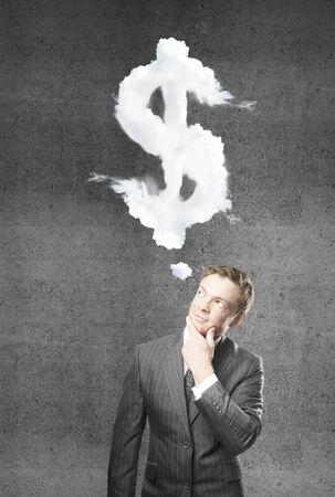 young businessman thinking on money Stock Photo - 24419045