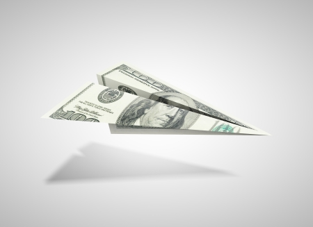 denominations: paper dollar plane on a gray background
