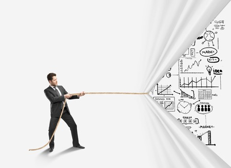 pulling rope: businessman pulling rope and drawing  business concept