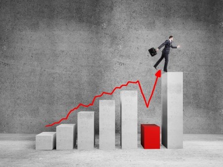businessman jumping: businessman jumping on big graph  in room