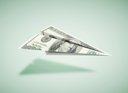 denominations: paper dollar plane on a green background