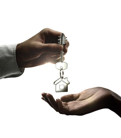 Man is handing a house key to a woman Stock Photo - 24415254