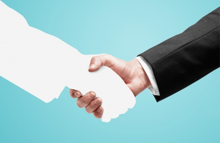 handshake on a blue background Stock Photo - 24415262