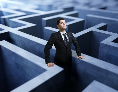 businessman standing in a maze photo