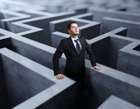 businessman standing in a labyrinth photo