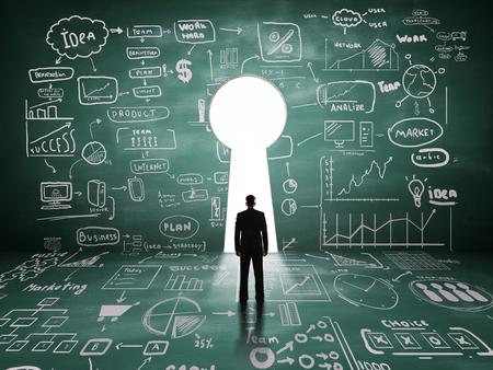 key ideas: businessman looking at  key hole door, business concept Stock Photo