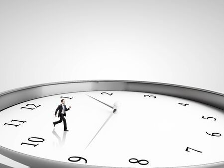 runing: businessman runing in clock on a gray background