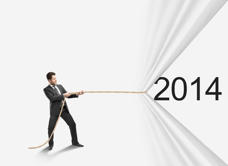 businessman pulling rope to 2014 photo
