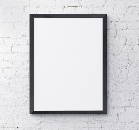 picture frame on wall: black frame on brick wall