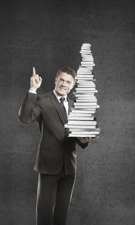 businessman with books on a white background Stock Photo - 24613722