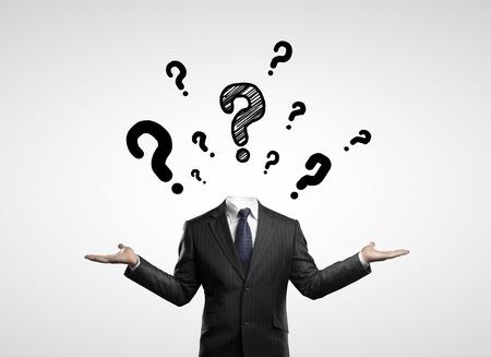 businessman with questions symbol over head Standard-Bild