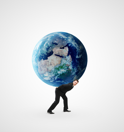young businessman holding earth on a white background photo
