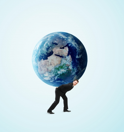 businessman holding earth on a blue background photo