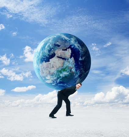businessman holding earth on a sky background photo