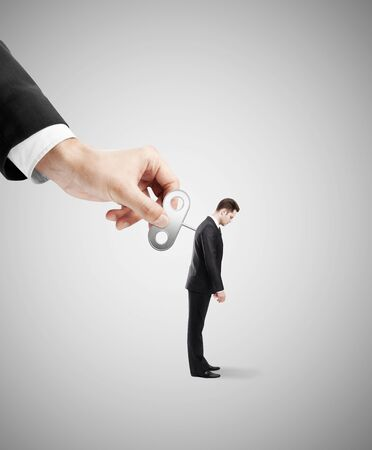 winder: winder in hand of a businessman gets