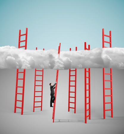 businessman climbing on red ledder to cloud photo