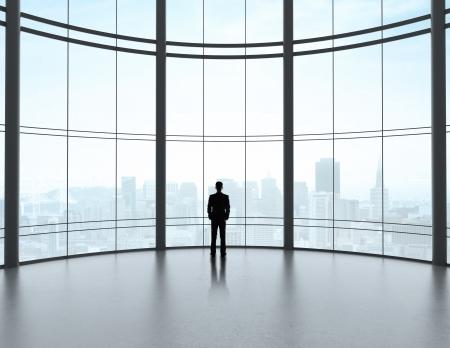 office lighting: businessman in big modern office Stock Photo