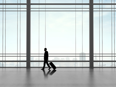 businessman walking in futuristic office with luggage photo