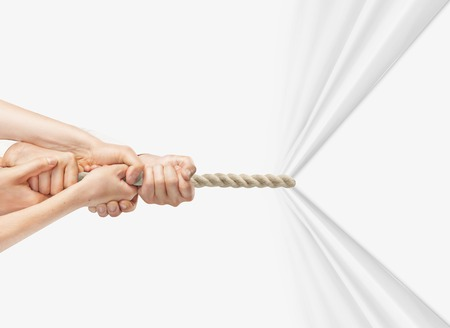 turn sign: hands pulling rope on a white background