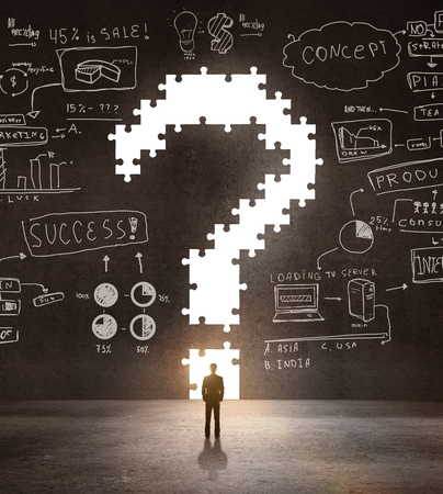 businessman looking an big question mark and drawing concept photo