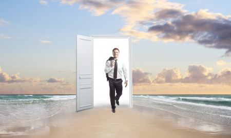 out door: happiness businessman  walking out door on beach Stock Photo