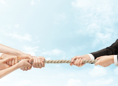 tug of war: arious hands during tug war on sky backgrounds