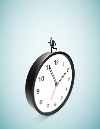 runing: businessman runing on clock on ablue background Stock Photo