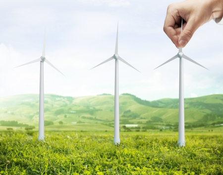landscape and hand holding eco air turbine photo
