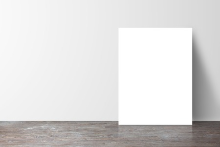 blank wall: poster standing next to a white wall
