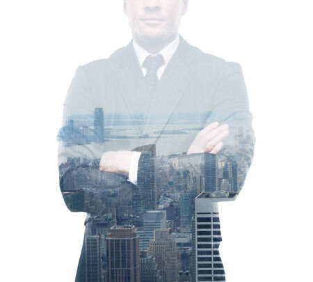 young businessman in suit standing on city background photo