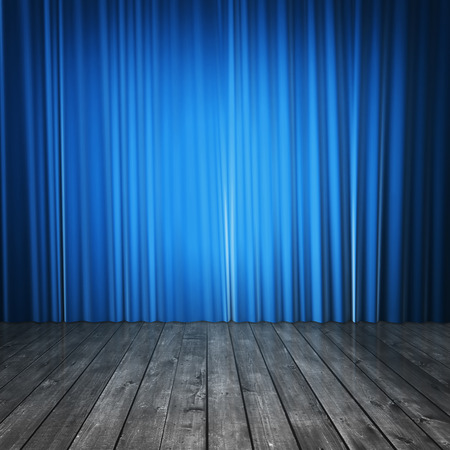 comedy show: blue curtains and concrete floor