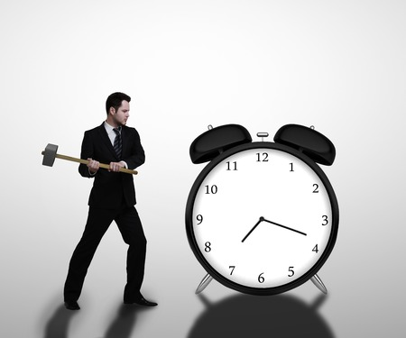 businessman breaks sledgehammer big clock  on a white background